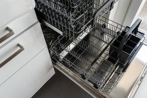 Birdseye view of an empty stainless steal dishwasher