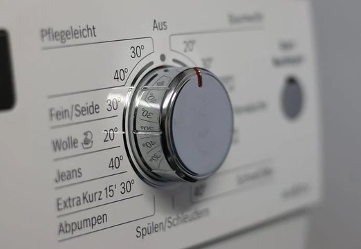 Close up shot of a laundry machine knob